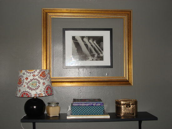 I used an empty ornate frame to go around a smaller picture of Grand Central Station that I already owned. This simple project created a piece of art large enough to go above my full-size bed. Photo By Kirsten Hudson